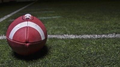 Football stationary on turfed football field
