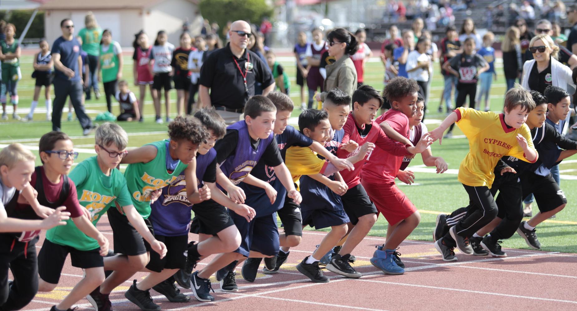 Kids running at the beginning of a race