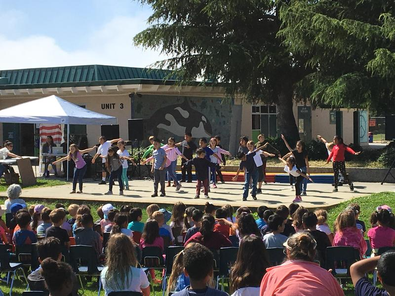 Students perform a dance.