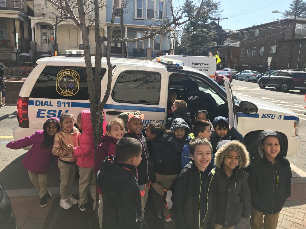 boys and girls in front of the ucpd ESU suv