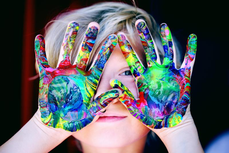 Kids with paint on hands