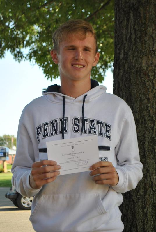 picture of Andrew outside with his letter