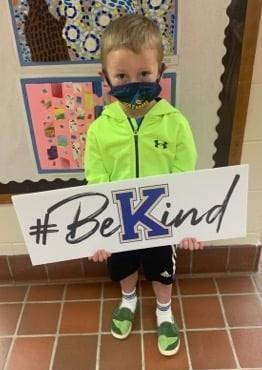kids with bekind sign