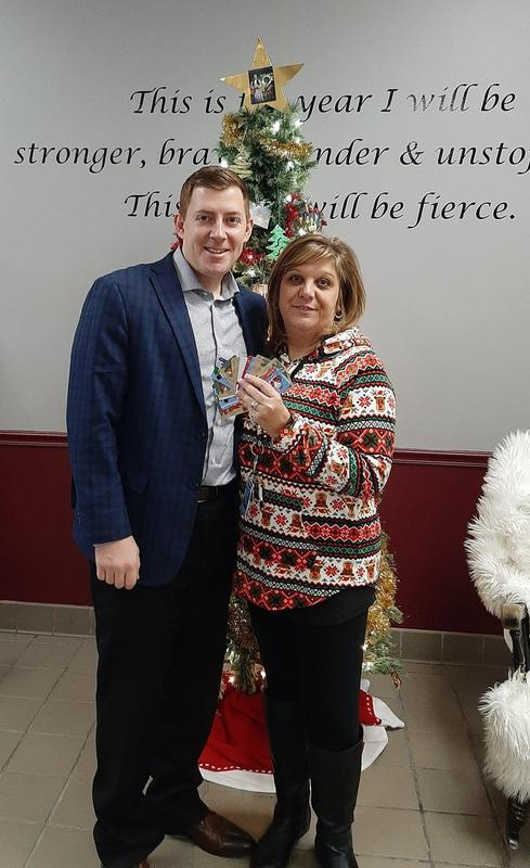 Mike Fleming presents Luann Murtha with a donation from Aflac.