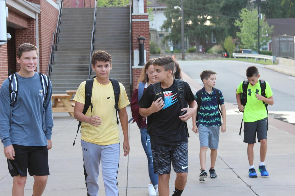 Middle school students walking to class.