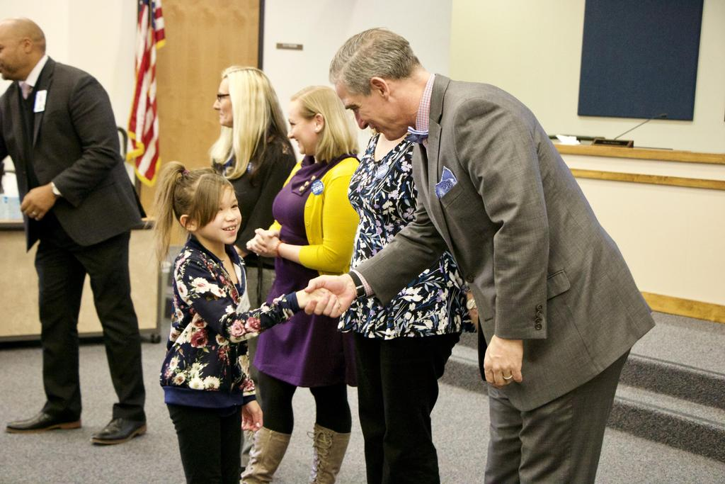 Students shake hands with spelling bee judges