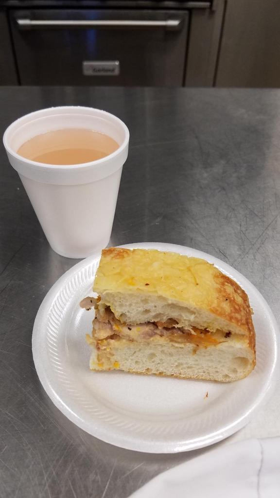 Pork Belly Sandwich w/ sauteed onions & sun dried tomato aioli mayo w/Lavender Lemonade