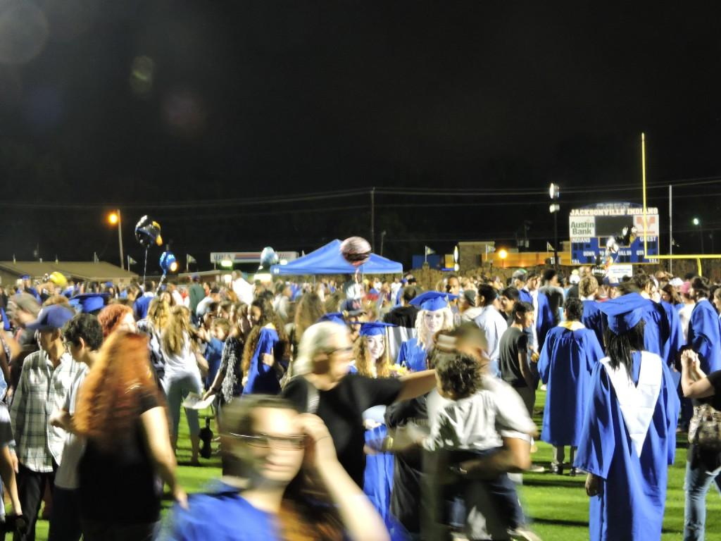 graduation crowd on the field