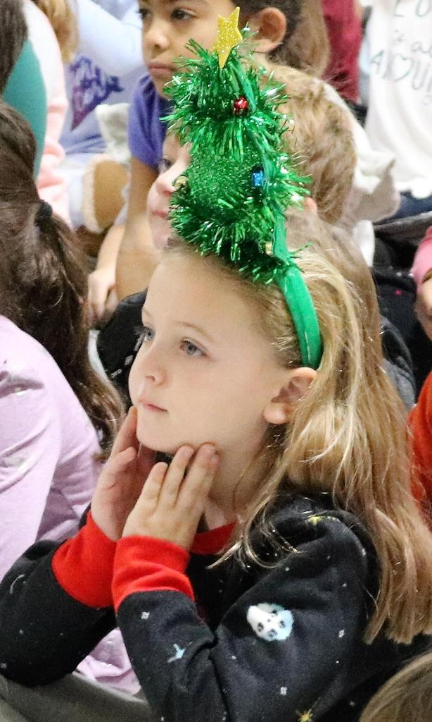 Photo of kindergarten wearing christmas tree headband.