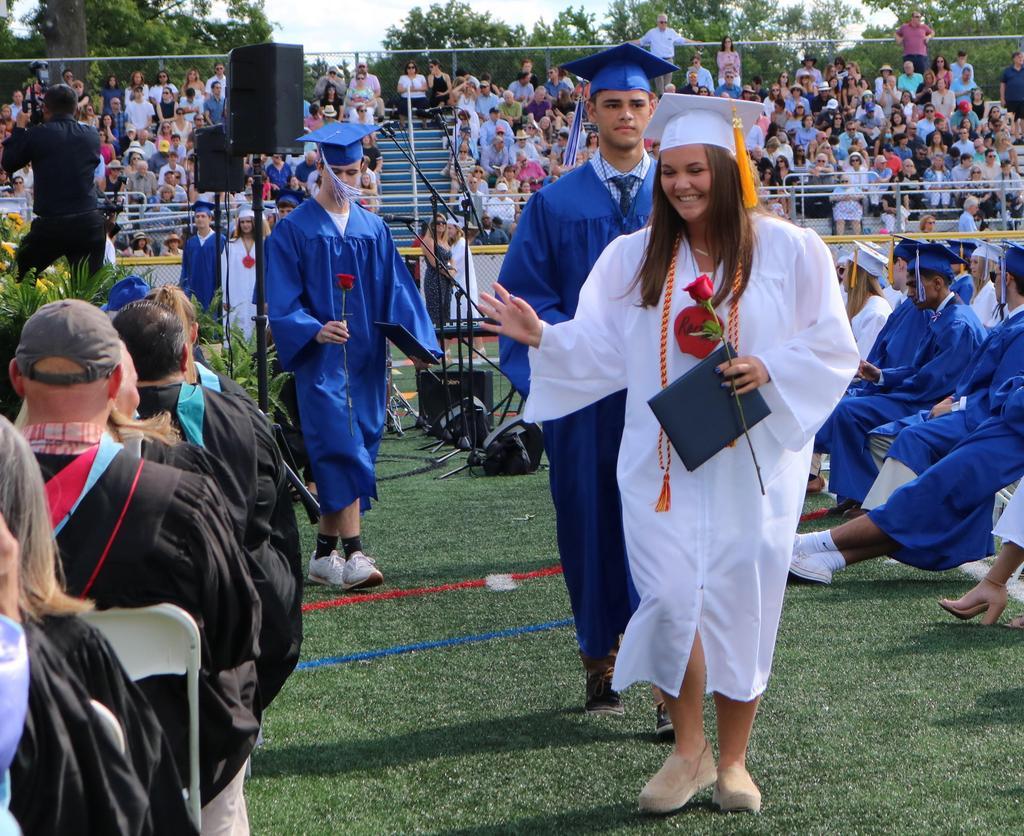 Photo of smiling graduates after receiving diplomas