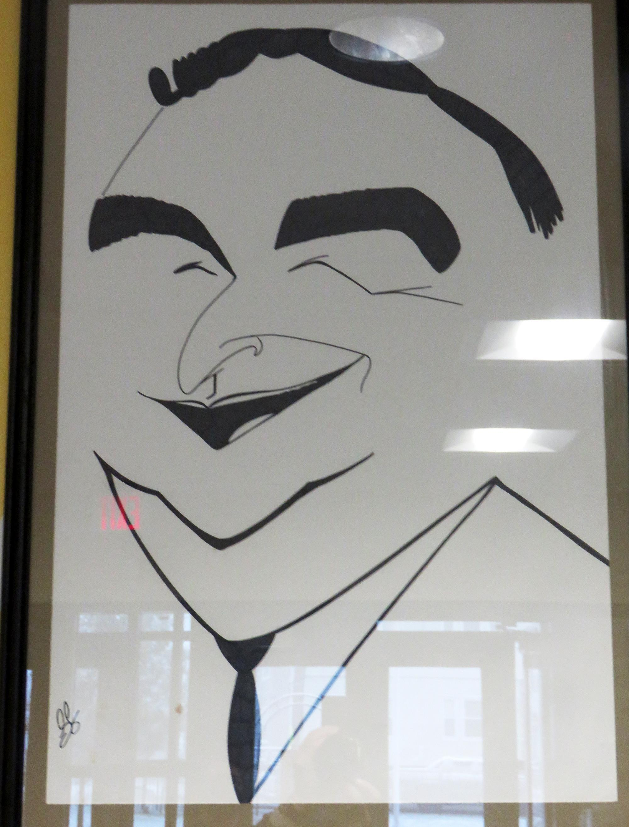 A caricature of a smiling George Keverian