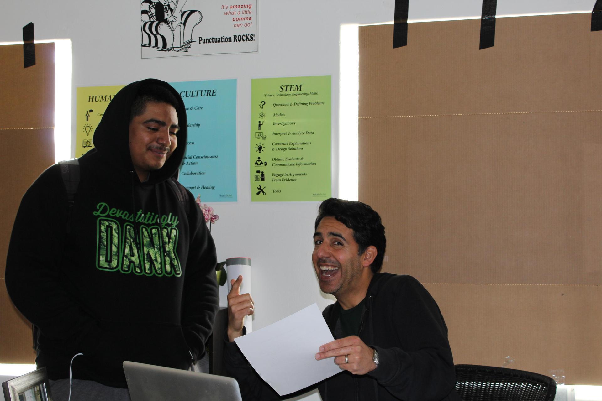 Mario Rosado with a student