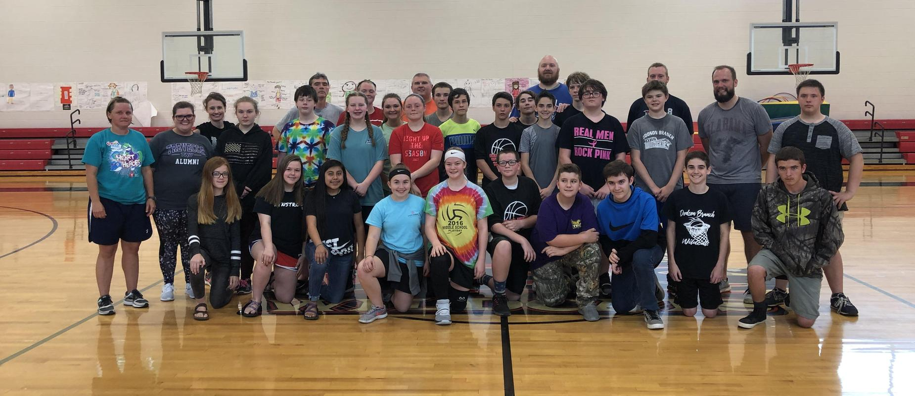 group picture for 8th grade vs teachers basketball game