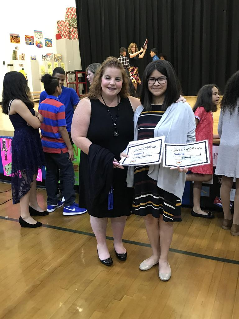 valeria with her teacher and her two certificate