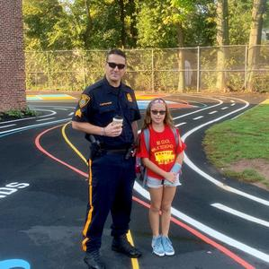 McKinley student gets special escort from a Westfield police officer on Walk to School Day.