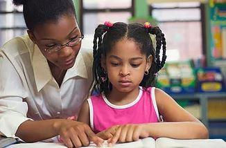 Teachers helping a student
