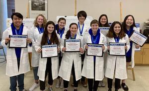 SPHS Seniors in white lab coats