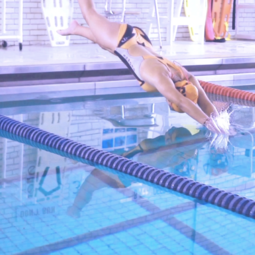 Student diving into the pool