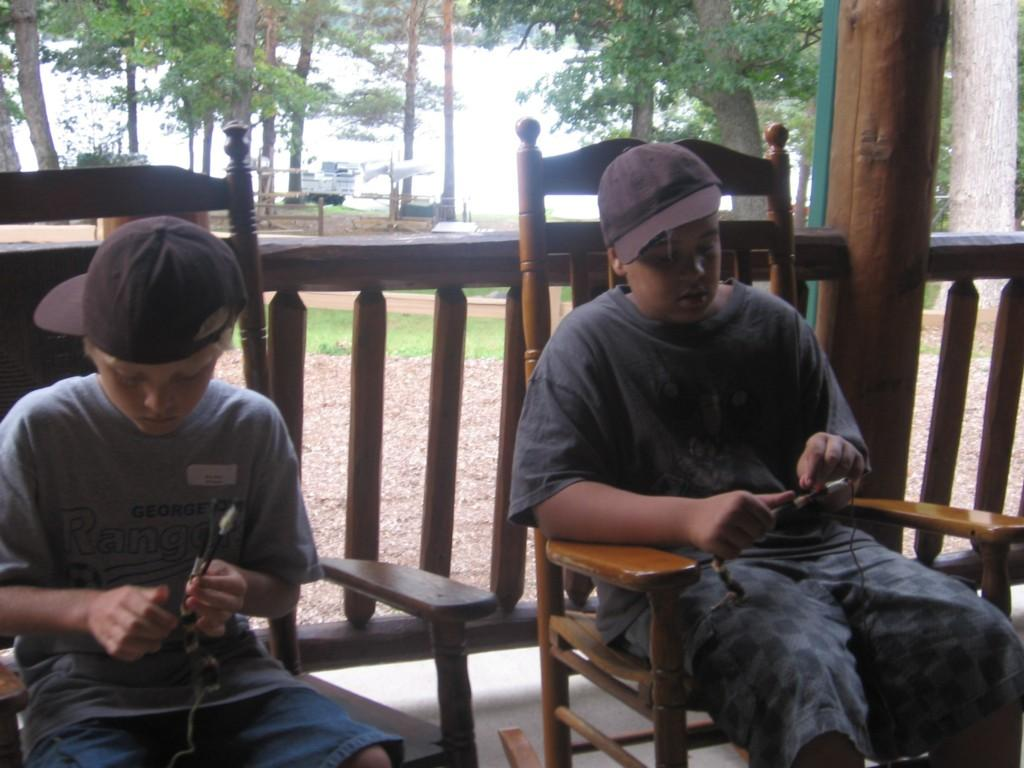 students in rocking chairs doing crafts