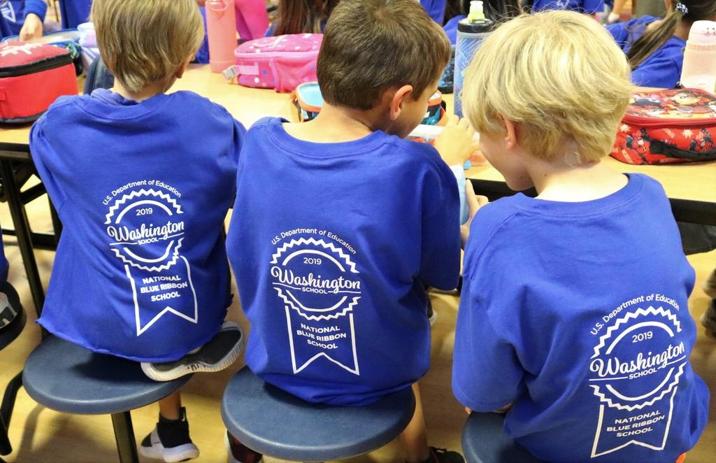 Photo of Washington School students wearing special National Blue Ribbon School shirts.