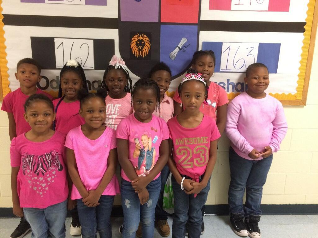 "Students participate in ""Pink Out Day"" for Breast Cancer Awareness."