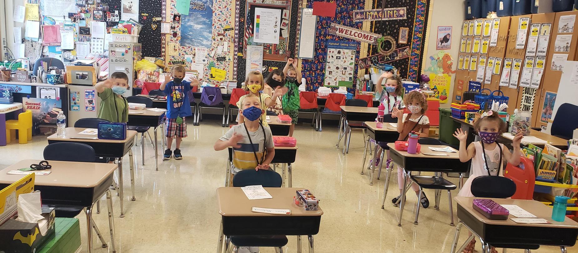 kindergarten students waving