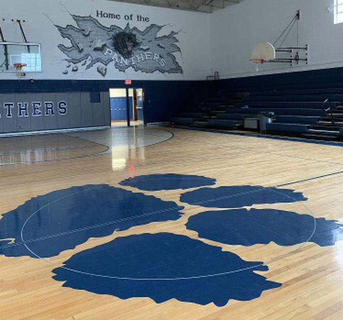 NMS gym with Home of the Panthers mural.