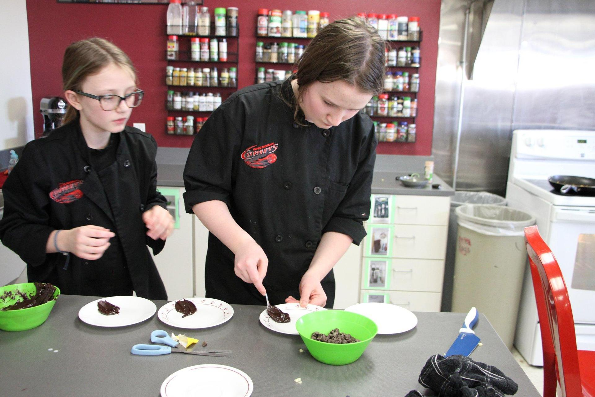 Two girls cooking in cooking class