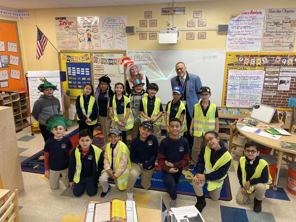 Mr. Webster with a class wearing construction alert gear
