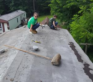 An OLSH student working on a roof during the 2018 mission trip