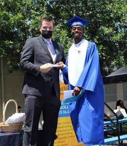 San Bernardino grad with teacher Adam Jones