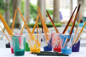 Paint and brushes in cups.