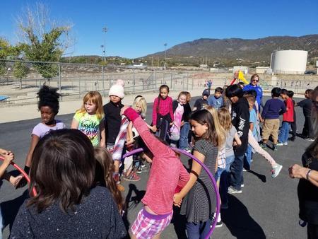 Students enjoying Hula Hoop