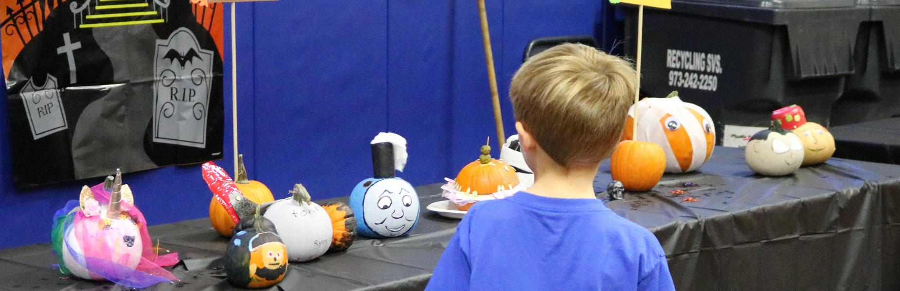 2nd grader at Wilson School enjoys looking at the many decorated pumpkins for the school's Pumpkin Patch.