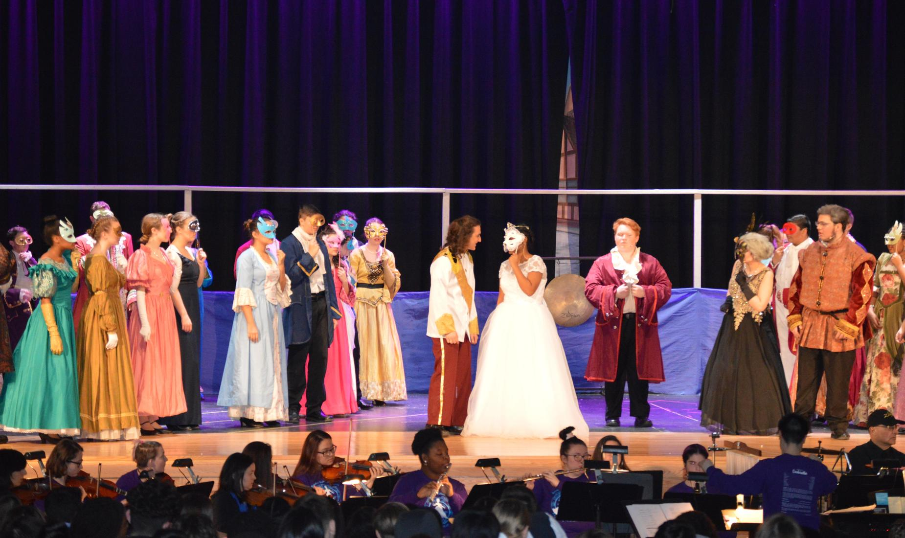 BHS Drama students, girls and boys, dressed in formal wear as they perform Cinderella