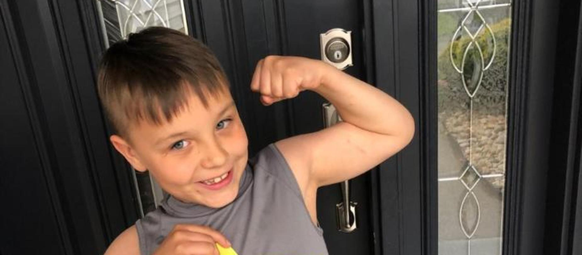Boy flexing his muscles