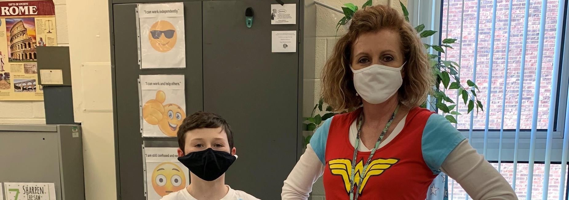 Mrs. Watkins and a student dressed as superheros