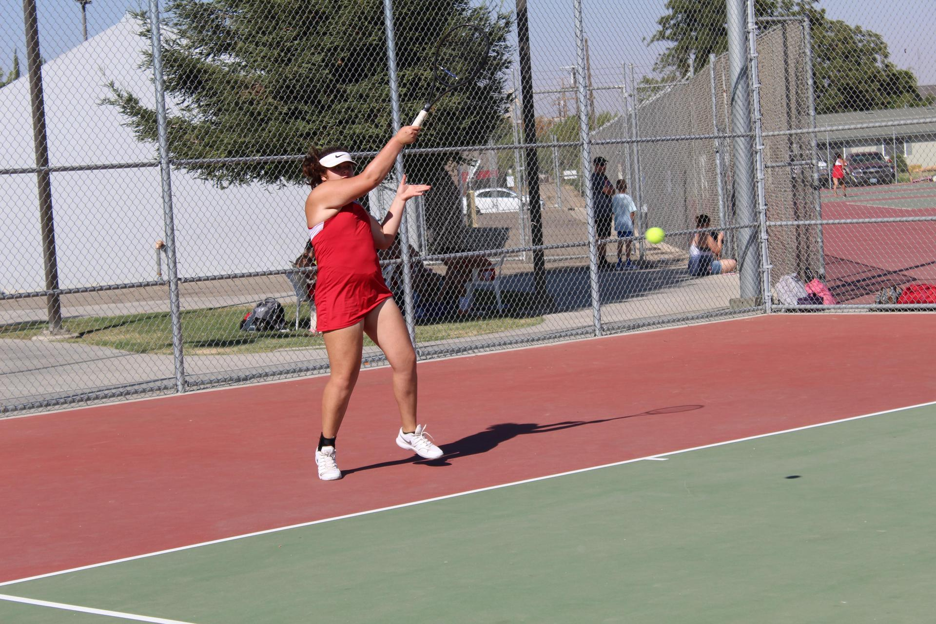 Girls playing Tennis vs Los Banos