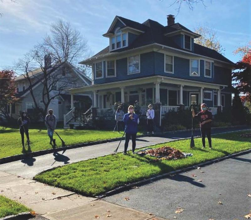 Members of the Westfield High School Community Service Club held a leaf-raking fundraiser in November, raising $1,250 in donations to help members of the community in need.