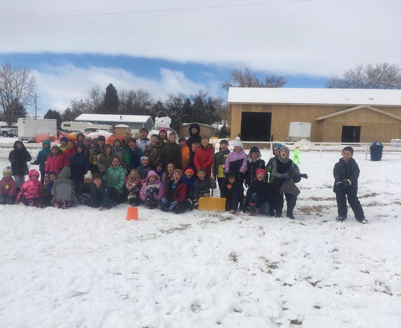 elementary students and snowman