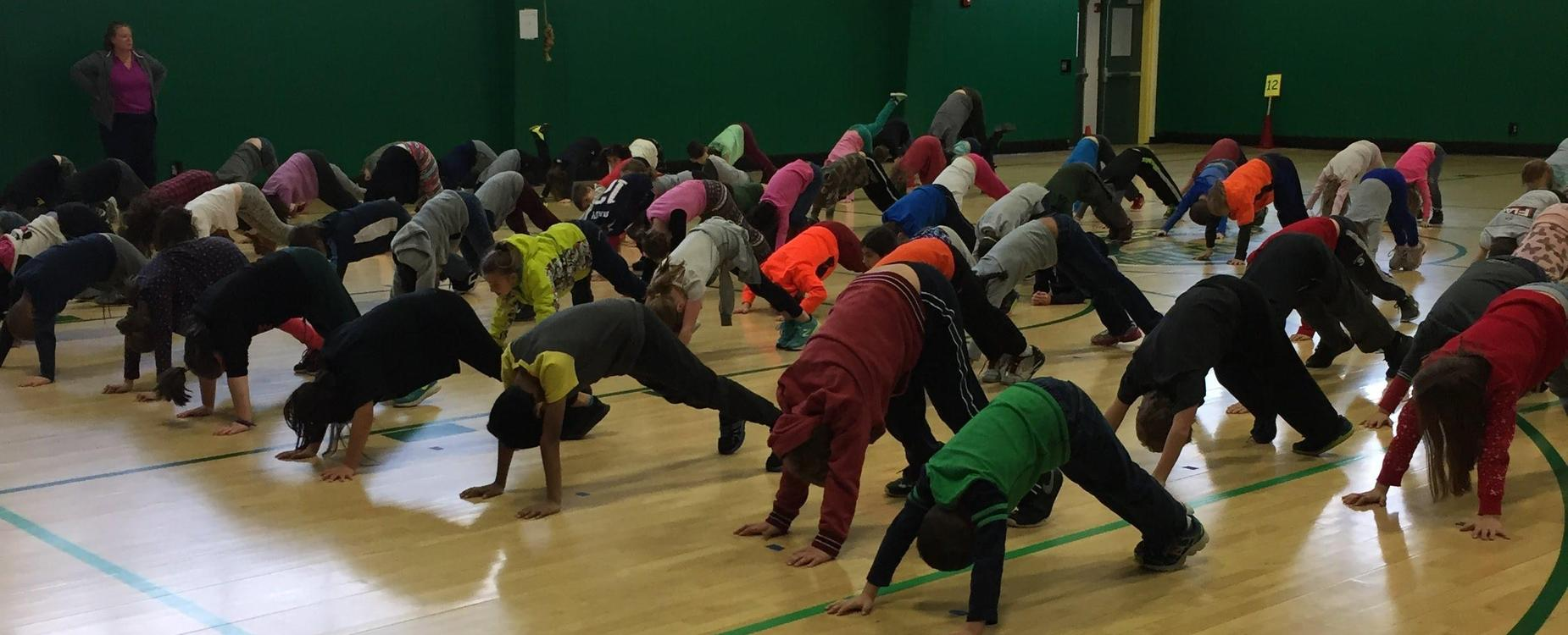 Students in the Downward Dog Yoga Pose