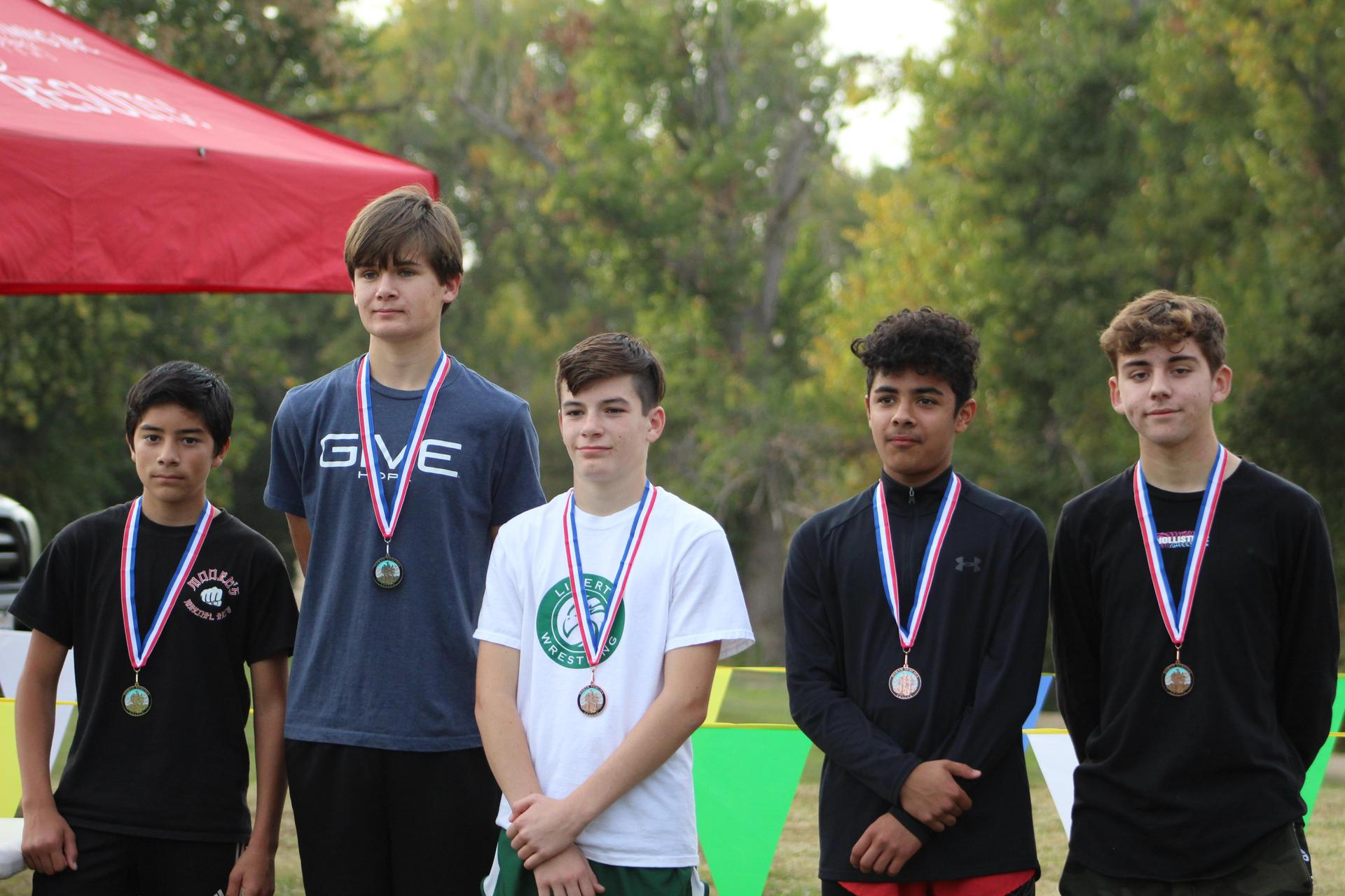 Issac Rivera, Tyler Henson, Angel Gonzales and Carson Borba with their metals