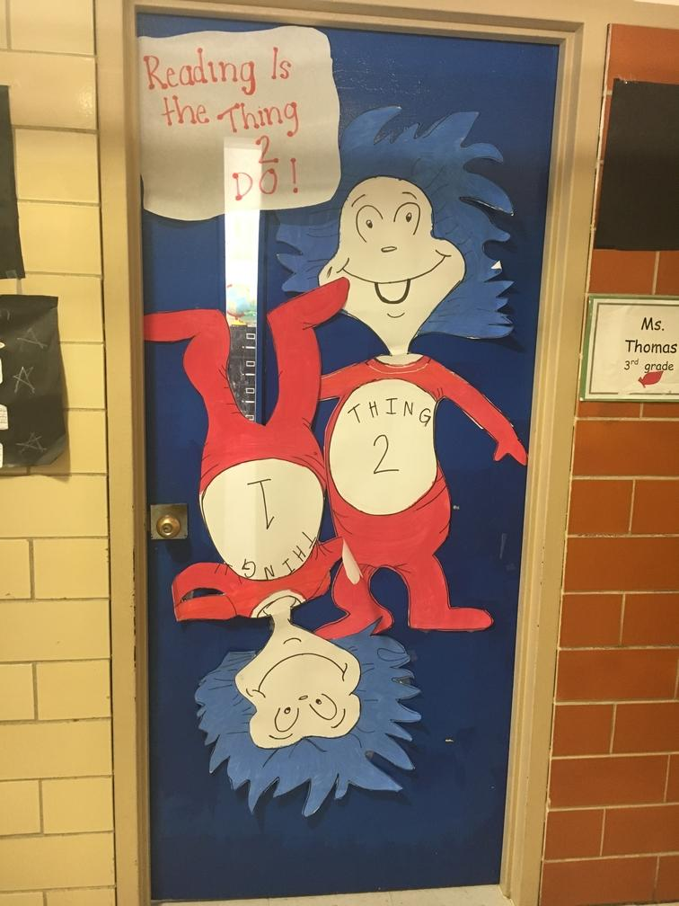 Door decorated with two red figures from whoville