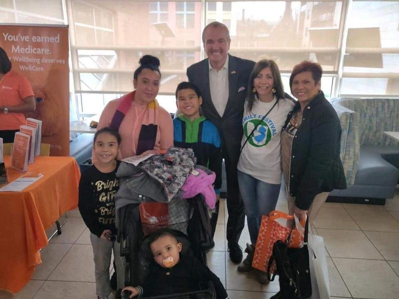 Governor Murphy with wife Tammy, parent Liaison B. Martinez and a mother with her two children