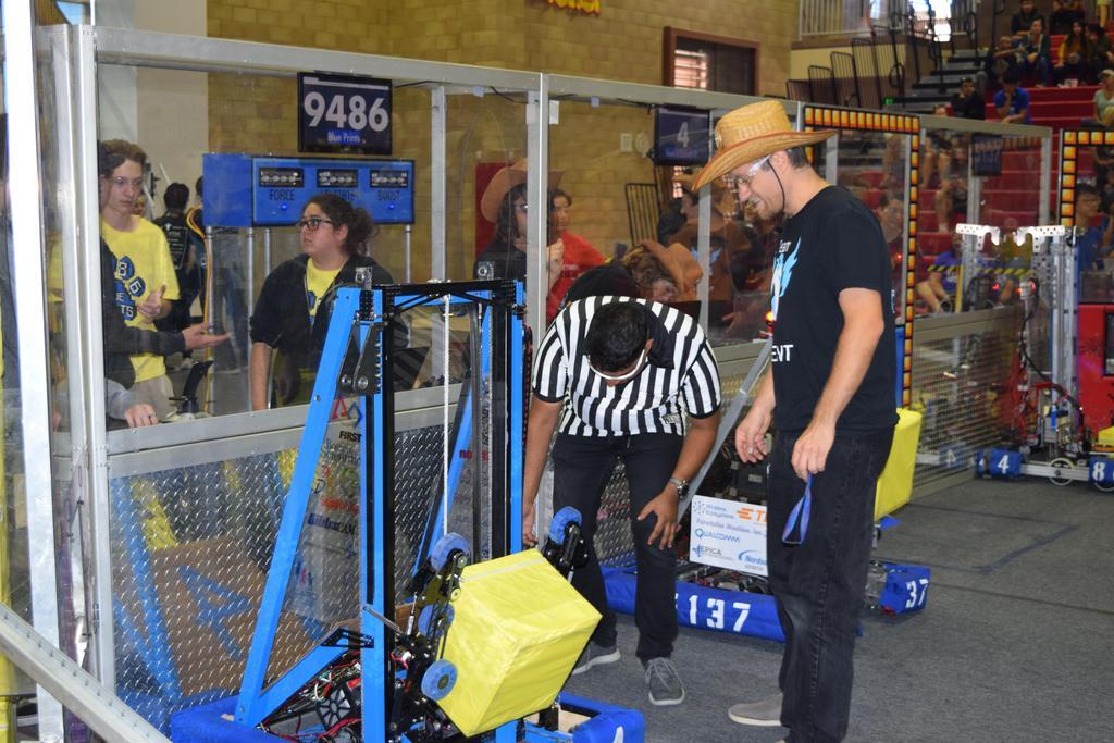 Ali and Mr. B checking robot