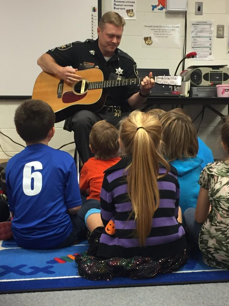 Students enjoyed listening to Officer Hebb sing for Red Ribbon Week celebration.