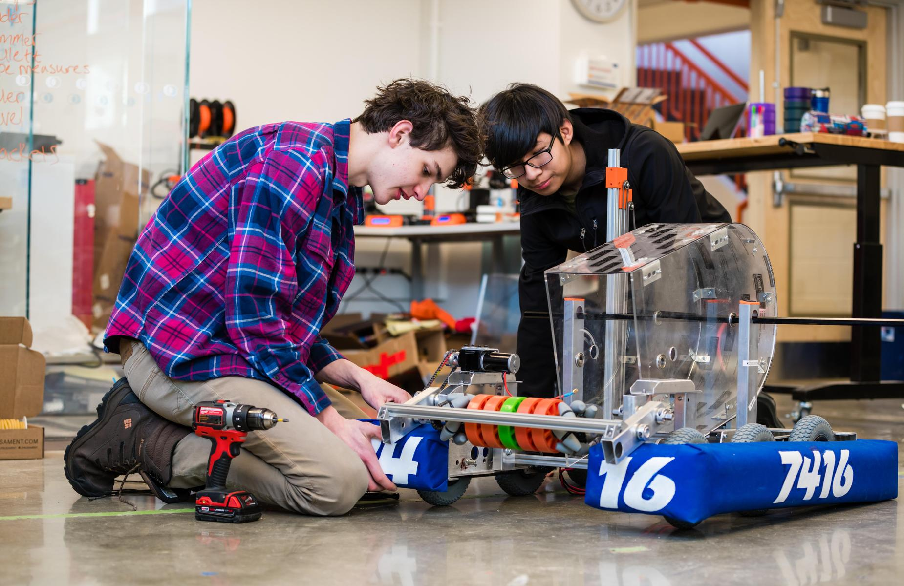 Two students working on a robot in the I^3 Lab.