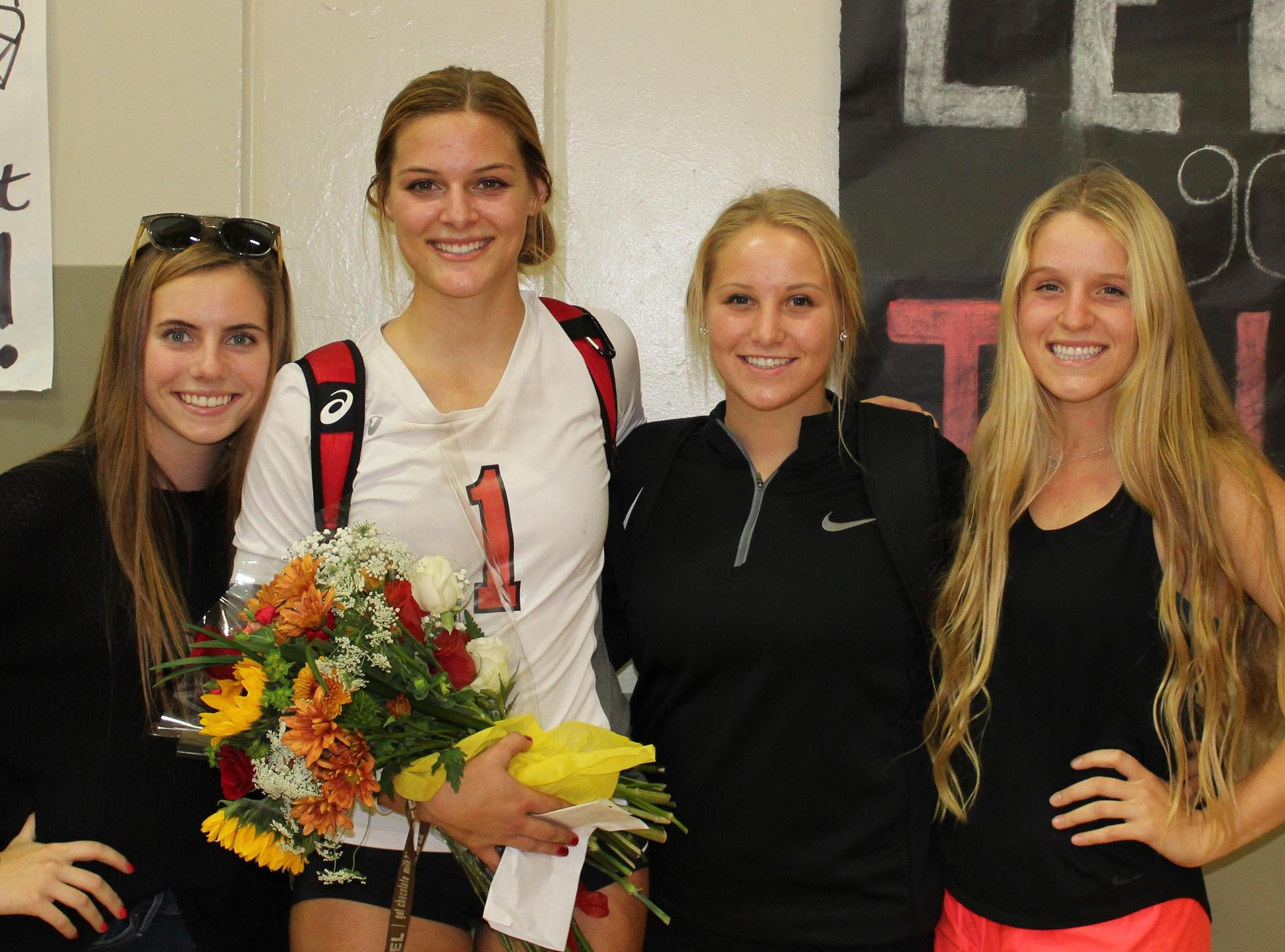 Kinsley Vlot poses with family on Volleyball Senior Night.