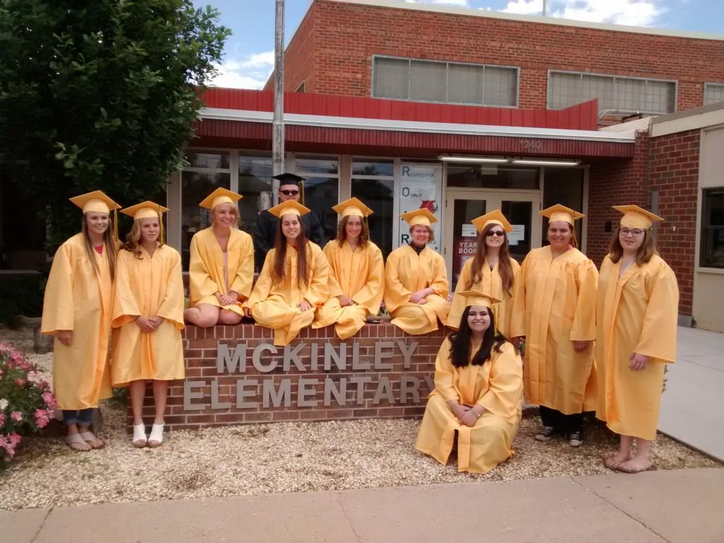 Congratulations Seniors! Posing in front of McKinley sign.