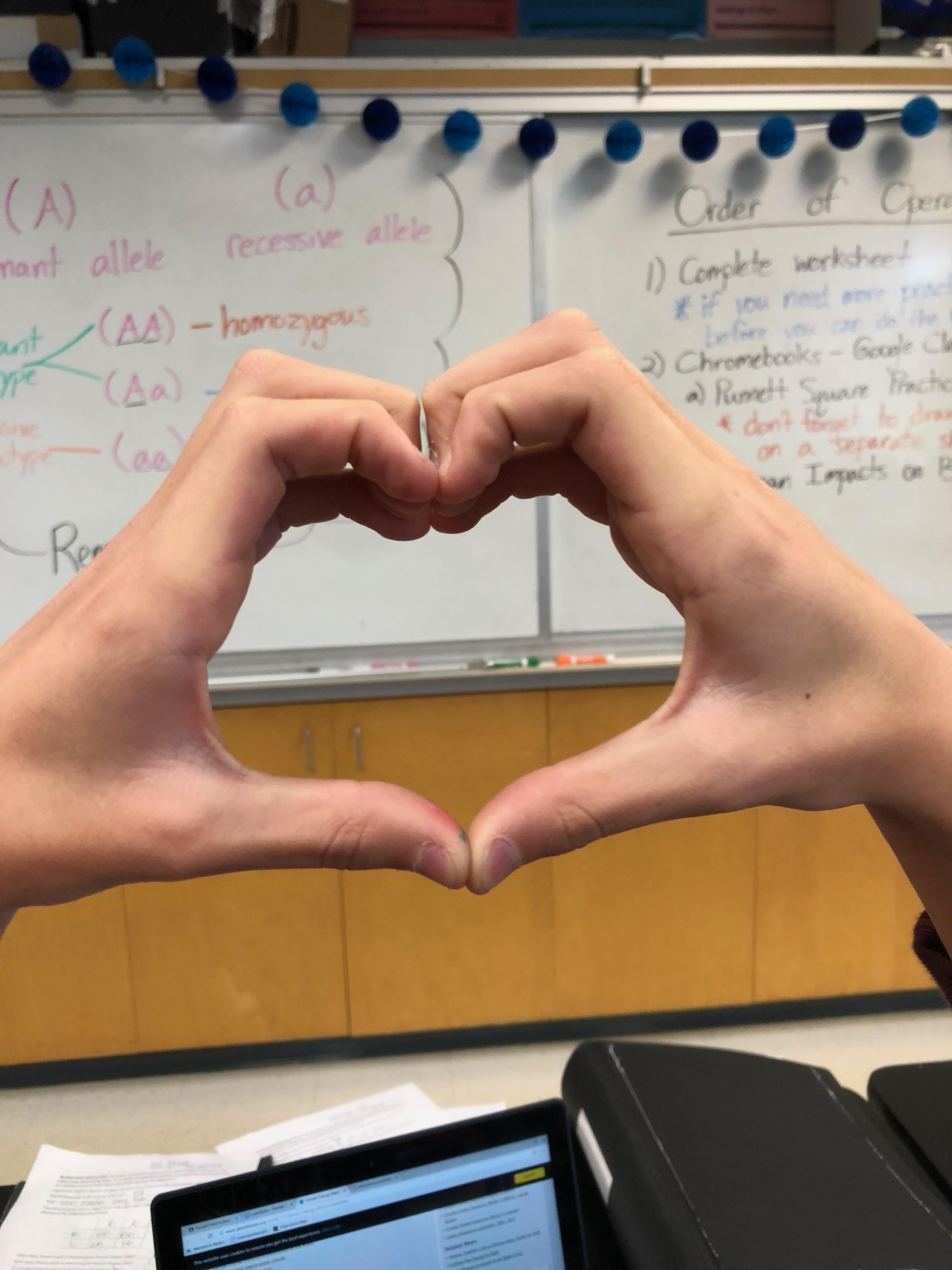 We love science. Hands in the shape of a heart.